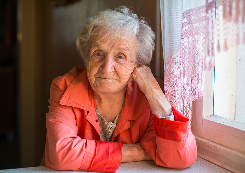 Elderly woman sitting at a table